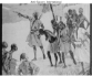 Slave traders exchange captured Africans for weapons